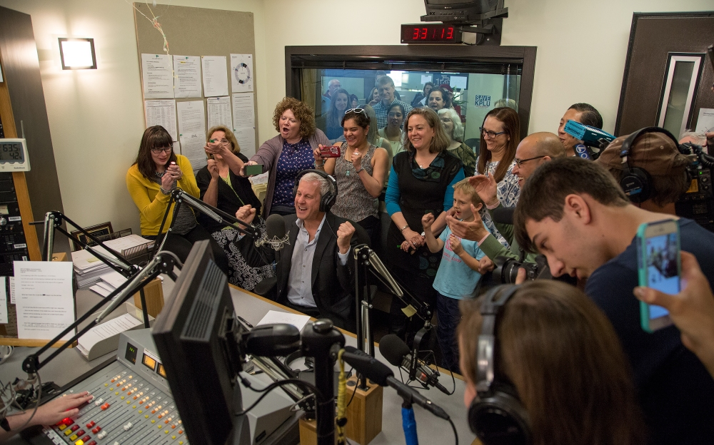 KPLU General Manager Joey Cohn, surrounded by KPLU staff and local media, announced that the Save KPLU campaign has hit its fundraising goal. Photo by Justin Steyer/KPLU